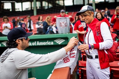 BOSTON, MA - MAY 16: Joe Kelly #56 of the Boston Red Sox signs autographs for fans before a game against the Oakland Athletics on May 16, 2018 at Fenway Park in Boston, Massachusetts. (Photo by Billie Weiss/Boston Red Sox/Getty Images) *** Local Caption *** Joe Kelly