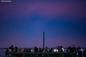 BOSTON, MA - MAY 16: The sun sets over the Green Monster during a game between the Boston Red Sox and the Oakland Athletics on May 16, 2018 at Fenway Park in Boston, Massachusetts. (Photo by Billie Weiss/Boston Red Sox/Getty Images) *** Local Caption ***