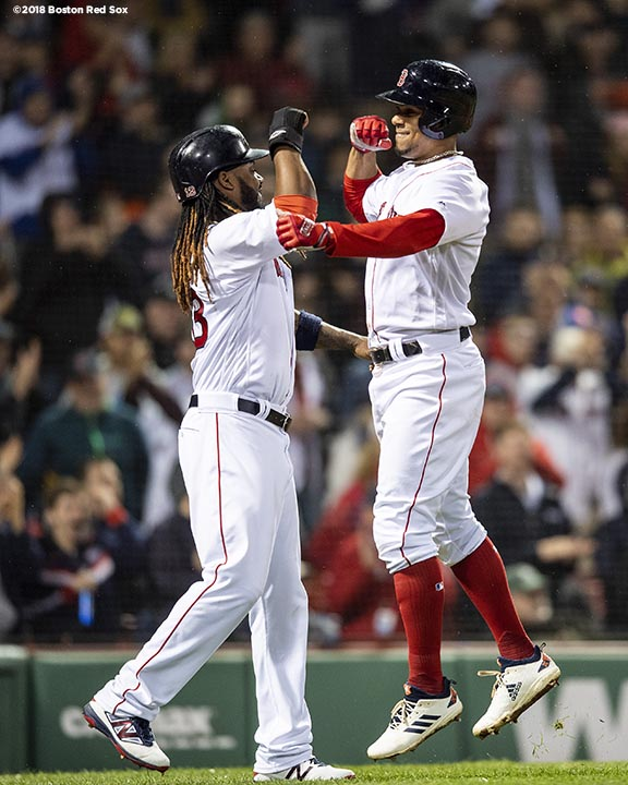 BOSTON, MA - MAY 16: Xander Bogaerts #2 of the Boston Red Sox reacts with Hanley Ramirez #13 after hitting a three run home run during the sixth inning of a game against the Oakland Athletics on May 16, 2018 at Fenway Park in Boston, Massachusetts. (Photo by Billie Weiss/Boston Red Sox/Getty Images) *** Local Caption *** Xander Bogaerts; Hanley Ramirez