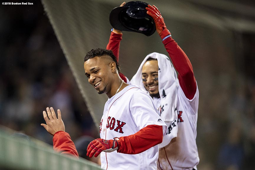 BOSTON, MA - MAY 16: Xander Bogaerts #2 of the Boston Red Sox reacts with Mookie Betts #50 after hitting a three run home run during the sixth inning of a game against the Oakland Athletics on May 16, 2018 at Fenway Park in Boston, Massachusetts. (Photo by Billie Weiss/Boston Red Sox/Getty Images) *** Local Caption *** Xander Bogaerts; Mookie Betts