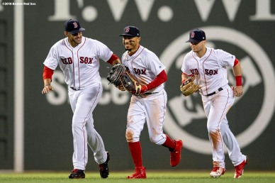 BOSTON, MA - MAY 16: J.D. Martinez #28, Mookie Betts #50, and Andrew Benintendi #16 of the Boston Red Sox celebrate a victory against the Oakland Athletics on May 16, 2018 at Fenway Park in Boston, Massachusetts. (Photo by Billie Weiss/Boston Red Sox/Getty Images) *** Local Caption *** J.D. Martinez; Mookie Betts; Andrew Benintendi