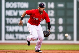 BOSTON, MA - MAY 18: Rafael Devers #11 of the Boston Red Sox fields a ground ball during the first inning of a game against the Baltimore Orioles on May 18, 2018 at Fenway Park in Boston, Massachusetts. (Photo by Billie Weiss/Boston Red Sox/Getty Images) *** Local Caption *** Rafael Devers