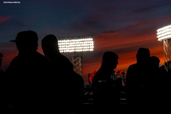 BOSTON, MA - MAY 18: Fans look on as the sun sets over the facade during a game between the Boston Red Sox and the Baltimore Orioles on May 18, 2018 at Fenway Park in Boston, Massachusetts. (Photo by Billie Weiss/Boston Red Sox/Getty Images) *** Local Caption ***