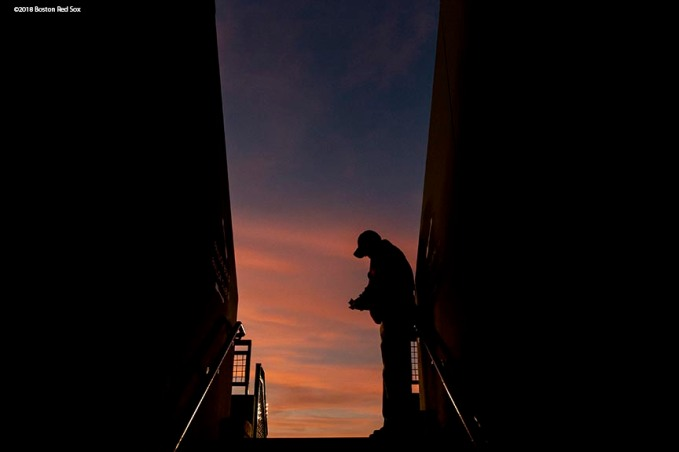 BOSTON, MA - MAY 18: A ticket tacker looks on as the sun sets over the facade during a game between the Boston Red Sox and the Baltimore Orioles on May 18, 2018 at Fenway Park in Boston, Massachusetts. (Photo by Billie Weiss/Boston Red Sox/Getty Images) *** Local Caption ***