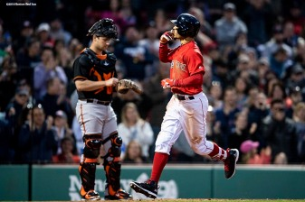 BOSTON, MA - MAY 18: Mookie Betts #50 of the Boston Red Sox reacts after hitting a home run during the third inning of a game against the Baltimore Orioles on May 18, 2018 at Fenway Park in Boston, Massachusetts. (Photo by Billie Weiss/Boston Red Sox/Getty Images) *** Local Caption *** Mookie Betts