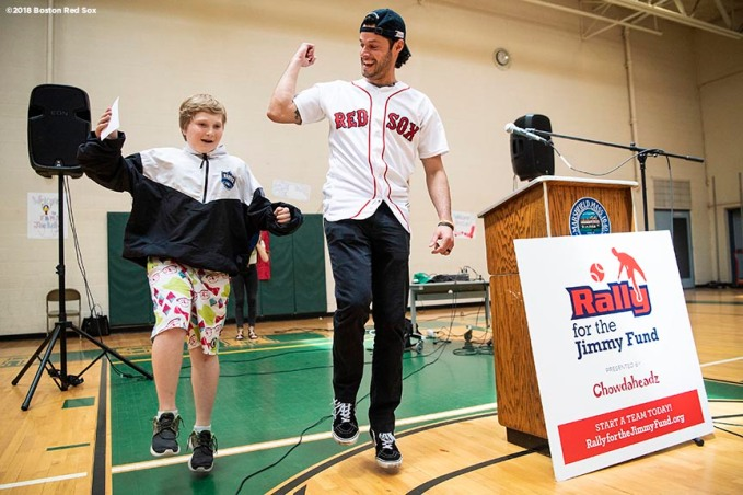 May 18, 2018, Boston, MA: Boston Red Sox pitcher Joe Kelly dances with a student during a visit for the Rally Against Cancer to Furnace Brook Middle School in Marshfield, Massachusetts Friday, May 18, 2018. (Photo by Billie Weiss/Boston Red Sox)