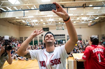 May 18, 2018, Boston, MA: Boston Red Sox pitcher Joe Kelly poses for a selfie photograph with students during a visit for the Rally Against Cancer to Furnace Brook Middle School in Marshfield, Massachusetts Friday, May 18, 2018. (Photo by Billie Weiss/Boston Red Sox)