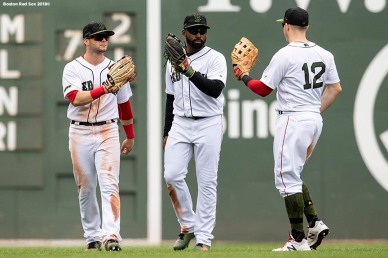 BOSTON, MA - MAY 28: Andrew Benintendi #16, Jackie Bradley Jr. #19, and Brock Holt #12 of the Boston Red Sox celebrate a victory against the Toronto Blue Jays on May 28, 2018 at Fenway Park in Boston, Massachusetts. (Photo by Billie Weiss/Boston Red Sox/Getty Images) *** Local Caption *** Andrew Benintendi; Brock Holt; Jackie Bradley Jr.