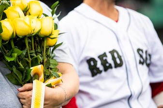 BOSTON, MA - MAY 28: Dustin Pedroia #15 of the Boston Red Sox escorts a gold star family in a ceremony in recognition of Memorial Day before a game against the Toronto Blue Jays on May 28, 2018 at Fenway Park in Boston, Massachusetts. (Photo by Billie Weiss/Boston Red Sox/Getty Images) *** Local Caption *** Dustin Pedroia