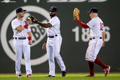 BOSTON, MA - MAY 29: Andrew Benintendi #16, Jackie Bradley Jr. #19, and Brock Holt #12 of the Boston Red Sox celebrate a victory against the Toronto Blue Jays on May 29, 2018 at Fenway Park in Boston, Massachusetts. (Photo by Billie Weiss/Boston Red Sox/Getty Images) *** Local Caption *** Andrew Benintendi; Brock Holt; Jackie Bradley Jr.