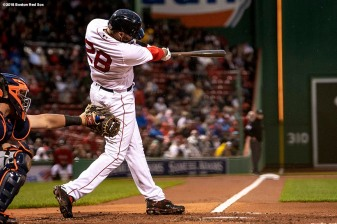 BOSTON, MA - JUNE 5: J.D. Martinez #28 of the Boston Red Sox hits a two run home run during the first inning of a game against the Detroit Tigers on June 5, 2018 at Fenway Park in Boston, Massachusetts. (Photo by Billie Weiss/Boston Red Sox/Getty Images) *** Local Caption *** J.D. Martinez