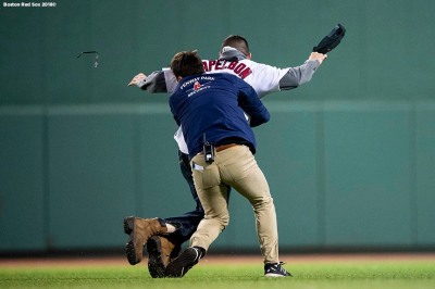 BOSTON, MA - JUNE 6: A fan is tackled by a member of security after running onto the field during the fifth inning of a game between the Boston Red Sox and the Detroit Tigers on June 6, 2018 at Fenway Park in Boston, Massachusetts. (Photo by Billie Weiss/Boston Red Sox/Getty Images) *** Local Caption ***