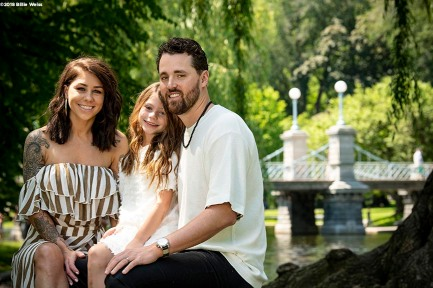 """The Hembree family poses for portraits in the Boston Public Garden in Boston, Massachusetts."""