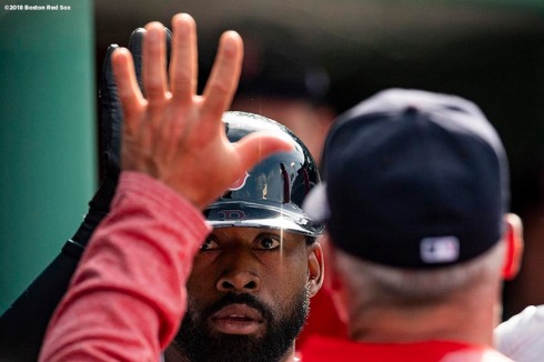 BOSTON, MA - JUNE 9: Jackie Bradley Jr. #19 of the Boston Red Sox high fives teammates after hitting a solo home run during the second inning of a game against the Chicago White Sox on June 9, 2018 at Fenway Park in Boston, Massachusetts. (Photo by Billie Weiss/Boston Red Sox/Getty Images) *** Local Caption *** Jackie Bradley Jr.