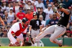 BOSTON, MA - JUNE 10: Sandy Leon #3 of the Boston Red Sox misses the ball as Jose Abreu #79 of the Chicago White Sox slides into home plate to score during the ninth inning of a game on June 10, 2018 at Fenway Park in Boston, Massachusetts. (Photo by Billie Weiss/Boston Red Sox/Getty Images) *** Local Caption *** Sandy Leon; Jose Abreu