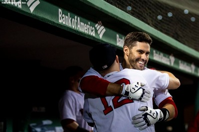BOSTON, MA - JUNE 26: J.D. Martinez #28 of the Boston Red Sox hugs Brock Holt #12 after hitting a solo home run during the sixth inning of a game against the Los Angeles Angels of Anaheim on June 26, 2018 at Fenway Park in Boston, Massachusetts. (Photo by Billie Weiss/Boston Red Sox/Getty Images) *** Local Caption *** J.D. Martinez; Brock Holt
