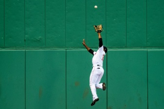 BOSTON, MA - JUNE 28: Jackie Bradley Jr. #19 of the Boston Red Sox leaps as he catches a fly ball during the first inning of a game against the Los Angeles Angels of Anaheim on June 28, 2018 at Fenway Park in Boston, Massachusetts. (Photo by Billie Weiss/Boston Red Sox/Getty Images) *** Local Caption *** Jackie Bradley Jr.