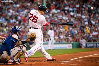 BOSTON, MA - JULY 9: Steve Pearce #25 of the Boston Red Sox hits a two run home run during the first inning of a game against the Texas Rangers on July 9, 2018 at Fenway Park in Boston, Massachusetts. (Photo by Billie Weiss/Boston Red Sox/Getty Images) *** Local Caption *** Steve Pearce