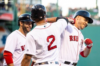 BOSTON, MA - JULY 9: Steve Pearce #25 of the Boston Red Sox reacts with J.D. Martinez #28 and Xander Bogaerts #2 after hitting a two run home run during the first inning of a game against the Texas Rangers on July 9, 2018 at Fenway Park in Boston, Massachusetts. (Photo by Billie Weiss/Boston Red Sox/Getty Images) *** Local Caption *** Steve Pearce; Xander Bogaerts; J.D. Martinez