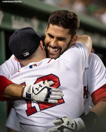 BOSTON, MA - JULY 9: J.D. Martinez #28 of the Boston Red Sox hugs Brock Holt #12 after hitting a three run home run during the eighth inning of a game against the Texas Rangers on July 9, 2018 at Fenway Park in Boston, Massachusetts. (Photo by Billie Weiss/Boston Red Sox/Getty Images) *** Local Caption *** J.D. Martinez; Brock Holt