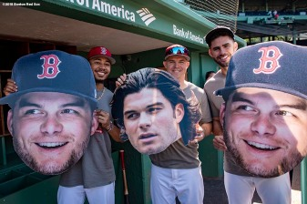 BOSTON, MA - JULY 10: Mookie Betts #50, Brock Holt #12 and J.D. Martinez #28 of the Boston Red Sox pose for a photograph with big head cutouts of Andrew Benintendi #16 before a game against the Texas Rangers on July 10, 2018 at Fenway Park in Boston, Massachusetts. (Photo by Billie Weiss/Boston Red Sox/Getty Images) *** Local Caption *** Brock Holt; J.D. Martinez; Andrew Benintendi; Mookie Betts