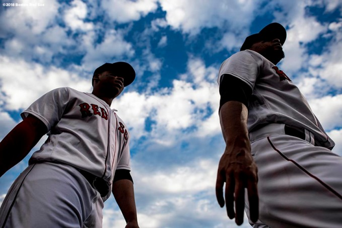 BOSTON, MA - JULY 10: Rafael Devers #11 and Xander Bogaerts #2 of the Boston Red Sox warm up before a game against the Texas Rangers on July 10, 2018 at Fenway Park in Boston, Massachusetts. (Photo by Billie Weiss/Boston Red Sox/Getty Images) *** Local Caption *** Rafael Devers; Xander Bogaerts