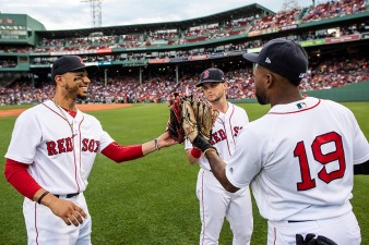 BOSTON, MA - JULY 10: Little leaguers take the field with Andrew Benintendi #16, Jackie Bradley Jr. #19, and Mookie Betts #50 of the Boston Red Sox high five before a game against the Texas Rangers on July 10, 2018 at Fenway Park in Boston, Massachusetts. (Photo by Billie Weiss/Boston Red Sox/Getty Images) *** Local Caption *** Andrew Benintendi; Jackie Bradley Jr.; Mookie Betts