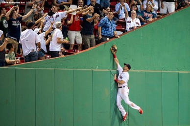 BOSTON, MA - JULY 10: Andrew Benintendi #16 of the Boston Red Sox attempts to catch a foul ball during the fourth inning of a game against the Texas Rangers on July 10, 2018 at Fenway Park in Boston, Massachusetts. (Photo by Billie Weiss/Boston Red Sox/Getty Images) *** Local Caption *** Andrew Benintendi