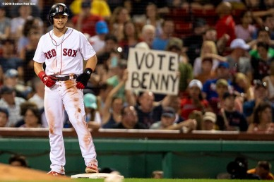 BOSTON, MA - JULY 10: A sign holds a fan as Andrew Benintendi #16 of the Boston Red Sox reacts after stealing third base during the seventh inning of a game against the Texas Rangers on July 10, 2018 at Fenway Park in Boston, Massachusetts. (Photo by Billie Weiss/Boston Red Sox/Getty Images) *** Local Caption *** Andrew Benintendi