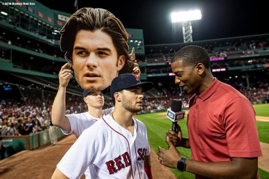 BOSTON, MA - JULY 10: Brock Holt #12 of the Boston Red Sox holds up a big-head cutout of Andrew Benintendi #16 as he is interview by Jahmai Webster of NESN after a game against the Texas Rangers on July 10, 2018 at Fenway Park in Boston, Massachusetts. (Photo by Billie Weiss/Boston Red Sox/Getty Images) *** Local Caption *** Brock Holt; Andrew Benintendi; Jahmai Webster