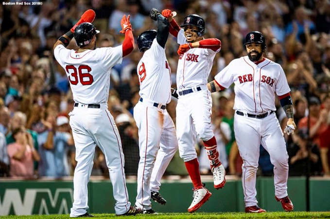 BOSTON, MA - JULY 12: Mookie Betts #50 of the Boston Red Sox reacts with Eduardo Nunez #36, Jackie Bradley Jr. #19, and Sandy Leon #3 after hitting a grand slam home run during the fourth inning of a game against the Toronto Blue Jays on July 12, 2018 at Fenway Park in Boston, Massachusetts. (Photo by Billie Weiss/Boston Red Sox/Getty Images) *** Local Caption *** Mookie Betts; Sandy Leon; Eduardo Nunez; Jackie Bradley Jr.