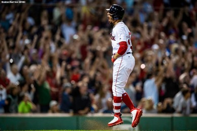 BOSTON, MA - JULY 12: Mookie Betts #50 of the Boston Red Sox reacts after hitting a grand slam home run during the fourth inning of a game against the Toronto Blue Jays on July 12, 2018 at Fenway Park in Boston, Massachusetts. (Photo by Billie Weiss/Boston Red Sox/Getty Images) *** Local Caption *** Mookie Betts