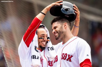 BOSTON, MA - JULY 14: J.D. Martinez #28 of the Boston Red Sox has his helmet removed by Mookie Betts #50 after hitting a solo home run during the fourth inning of a game against the Toronto Blue Jays on July 14, 2018 at Fenway Park in Boston, Massachusetts. (Photo by Billie Weiss/Boston Red Sox/Getty Images) *** Local Caption *** J.D. Martinez; Mookie Betts