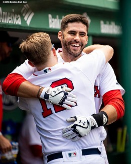 BOSTON, MA - JULY 14: J.D. Martinez #28 of the Boston Red Sox hugs Brock Holt #12 after hitting a solo home run during the fourth inning of a game against the Toronto Blue Jays on July 14, 2018 at Fenway Park in Boston, Massachusetts. (Photo by Billie Weiss/Boston Red Sox/Getty Images) *** Local Caption *** J.D. Martinez; Brock Holt