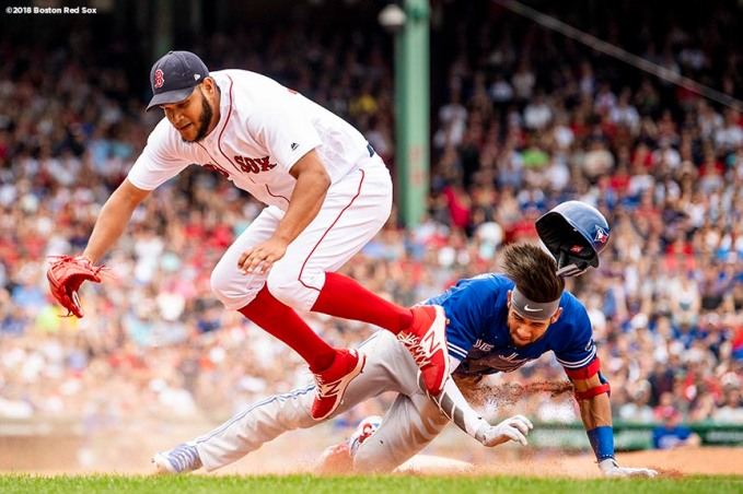 BOSTON, MA - JULY 14: Eduardo Rodriguez #57 of the Boston Red Sox collides with Lourdes Gurriel Jr. after covering first base and recording the out during the sixth inning of a game against the Toronto Blue Jays on July 14, 2018 at Fenway Park in Boston, Massachusetts. (Photo by Billie Weiss/Boston Red Sox/Getty Images) *** Local Caption *** Eduardo Rodriguez; Lourdes Gurriel Jr.