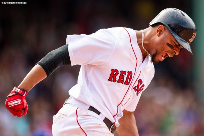 BOSTON, MA - JULY 14: Xander Bogaerts #2 of the Boston Red Sox reacts after hitting a walk-off grand slam home run during the tenth inning of a game against the Toronto Blue Jays on July 14, 2018 at Fenway Park in Boston, Massachusetts. (Photo by Billie Weiss/Boston Red Sox/Getty Images) *** Local Caption *** Xander Bogaerts