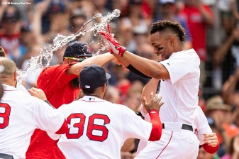 BOSTON, MA - JULY 14: Xander Bogaerts #2 of the Boston Red Sox reacts with teammates after hitting a walk-off grand slam home run during the tenth inning of a game against the Toronto Blue Jays on July 14, 2018 at Fenway Park in Boston, Massachusetts. (Photo by Billie Weiss/Boston Red Sox/Getty Images) *** Local Caption *** Xander Bogaerts