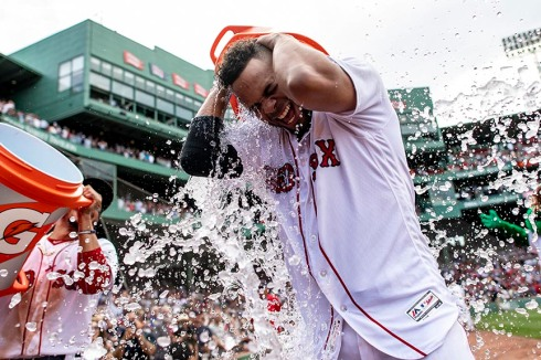 BOSTON, MA - JULY 14: Xander Bogaerts #2 of the Boston Red Sox reacts as he is doused with Gatorade after hitting a walk-off grand slam home run during the tenth inning of a game against the Toronto Blue Jays on July 14, 2018 at Fenway Park in Boston, Massachusetts. (Photo by Billie Weiss/Boston Red Sox/Getty Images) *** Local Caption *** Xander Bogaerts
