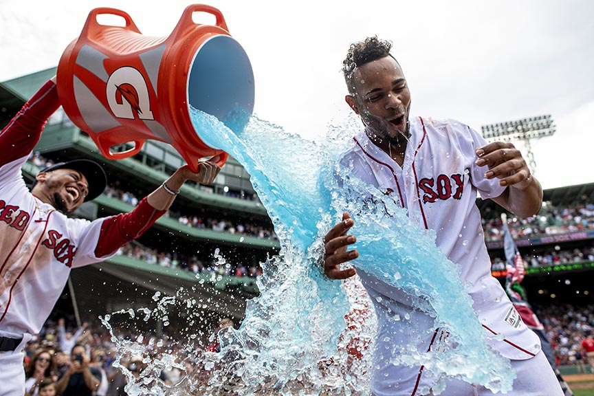 BOSTON, MA - JULY 14: Xander Bogaerts #2 of the Boston Red Sox reacts as he is doused with Gatorade by Mookie Betts #50 after hitting a walk-off grand slam home run during the tenth inning of a game against the Toronto Blue Jays on July 14, 2018 at Fenway Park in Boston, Massachusetts. (Photo by Billie Weiss/Boston Red Sox/Getty Images) *** Local Caption *** Xander Bogaerts; Mookie Betts