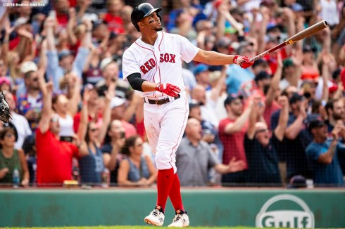 BOSTON, MA - JULY 14: Xander Bogaerts #2 of the Boston Red Sox hits a walk-off grand slam home run during the tenth inning of a game against the Toronto Blue Jays on July 14, 2018 at Fenway Park in Boston, Massachusetts. (Photo by Billie Weiss/Boston Red Sox/Getty Images) *** Local Caption *** Xander Bogaerts