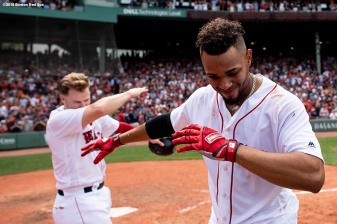 BOSTON, MA - JULY 14: Xander Bogaerts #2 of the Boston Red Sox reacts with Brock Holt #12 after hitting a walk-off grand slam home run during the tenth inning of a game against the Toronto Blue Jays on July 14, 2018 at Fenway Park in Boston, Massachusetts. (Photo by Billie Weiss/Boston Red Sox/Getty Images) *** Local Caption *** Xander Bogaerts; Brock Holt