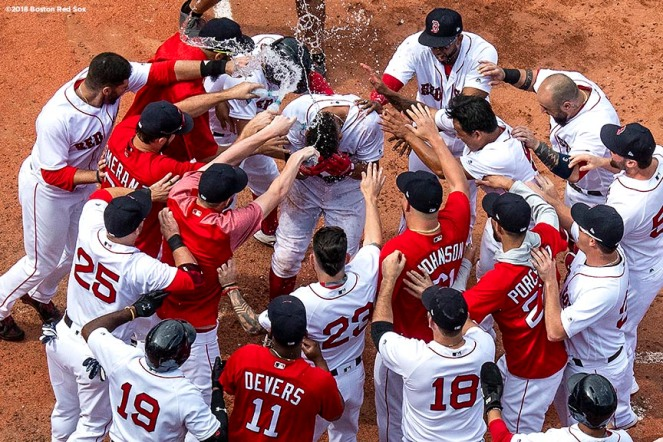 BOSTON, MA - JULY 14: Xander Bogaerts #2 of the Boston Red Sox is mobbed by teammates after hitting a walk-off grand slam home run during the tenth inning of a game against the Toronto Blue Jays on July 14, 2018 at Fenway Park in Boston, Massachusetts. (Photo by Billie Weiss/Boston Red Sox/Getty Images) *** Local Caption *** Xander Bogaerts
