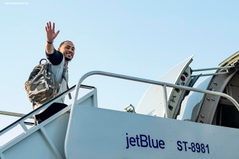 BOSTON, MA - JULY 15: Mookie Betts #50 of the Boston Red Sox waves as he boards the plane during a team charter flight to Washington, DC for the 2018 Major League Baseball All-Star Game Sunday, July 15, 2018. (Photo by Billie Weiss/Boston Red Sox/Getty Images) *** Local Caption *** Mookie Betts