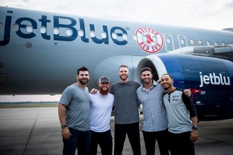 BOSTON, MA - JULY 15: Mitch Moreland #18, Craig Kimbrel #46, Chris Sale #41, J.D. Martinez #28, and Mookie Betts #50 of the Boston Red Sox pose for a photograph outside the plane during a team charter flight to Washington, DC for the 2018 Major League Baseball All-Star Game Sunday, July 15, 2018. (Photo by Billie Weiss/Boston Red Sox/Getty Images) *** Local Caption *** Mitch Moreland; Craig Kimbrel; Chris Sale; J.D. Martinez; Mookie Betts
