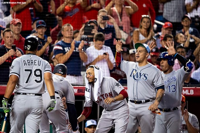 WASHINGTON, DC - JULY 17: Aaron Judge #99 of the New York Yankees reacts with Mookie Betts #50 of the Boston Red Sox after hitting a solo home run during the second inning of the 89th MLB All-Star Game at Nationals Park Tuesday, July 17, 2018 in Washington, DC. (Photo by Billie Weiss/Boston Red Sox/Getty Images) *** Local Caption *** Aaron Judge; Mookie Betts