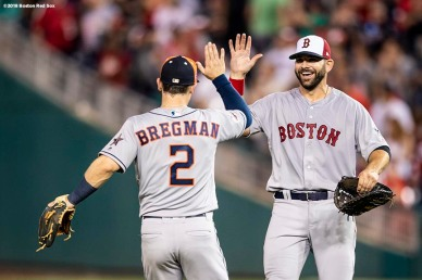 WASHINGTON, DC - JULY 17: Mitch Moreland #18 of the Boston Red Sox high fives Alex Bregman #2 of the Houston Astros after the 89th MLB All-Star Game at Nationals Park Tuesday, July 17, 2018 in Washington, DC. (Photo by Billie Weiss/Boston Red Sox/Getty Images) *** Local Caption *** Mitch Moreland; Alex Bregman