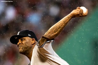 BOSTON, MA - AUGUST 2: CC Sabathia #52 of the New York Yankees delivers as rain falls during the second inning of a game against the Boston Red Sox on August 2, 2018 at Fenway Park in Boston, Massachusetts. (Photo by Billie Weiss/Boston Red Sox/Getty Images) *** Local Caption *** CC Sabathia
