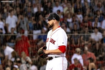 BOSTON, MA - AUGUST 2: Brian Johnson #61 of the Boston Red Sox stands on the mound as rain falls during the second inning of a game against the New York Yankees on August 2, 2018 at Fenway Park in Boston, Massachusetts. (Photo by Billie Weiss/Boston Red Sox/Getty Images) *** Local Caption *** Brian Johnson