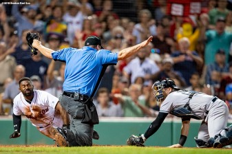 BOSTON, MA - AUGUST 2: Jackie Bradley Jr. #19 of the Boston Red Sox dives into home plate as he avoids the tag of Austin Romine #28 of the New York Yankees after getting caught in a run down during the fourth inning of a game on August 2, 2018 at Fenway Park in Boston, Massachusetts. (Photo by Billie Weiss/Boston Red Sox/Getty Images) *** Local Caption *** Jackie Bradley Jr.; Austin Romine