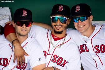 BOSTON, MA - AUGUST 4: Andrew Benintendi #16, Mookie Betts #50, and Brock Holt #12 of the Boston Red Sox pose for a photograph before a game against the New York Yankees on August 4, 2018 at Fenway Park in Boston, Massachusetts. (Photo by Billie Weiss/Boston Red Sox/Getty Images) *** Local Caption *** Andrew Benintendi; Brock Holt; Mookie Betts